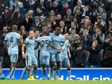 Manchester City's Ivorian midfielder Yaya Toure celebrates with teammates after scoring his team's second goal during the English Premier League football match between Manchester City and Swansea City at the The Etihad Stadium in Manchester, north west En