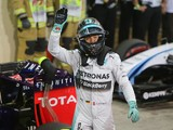 Mercedes-AMG's German driver Nico Rosberg celebrates in the parc ferme after the qualifying session at the Yas Marina circuit in Abu Dhabi on November 23, 2014