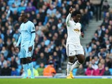 Wilfried Bony of Swansea City celebrates his opening goal during the Barclays Premier League match between Manchester City and Swansea City at Etihad Stadium on November 22, 2014