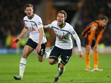 Christian Eriksen of Tottenham Hotspur celebrates scoring the winning goal with Jan Vertonghen during the Barclays Premier League match between Hull City and Tottenham Hotspur at KC Stadium on November 23, 2014