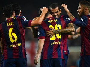 Lionel Messi of FC Barcelona celebrates with his teammates after scoring the opening goal during the La Liga mach between FC Barcelona and Sevilla FC at Camp Nou on November 22, 2014