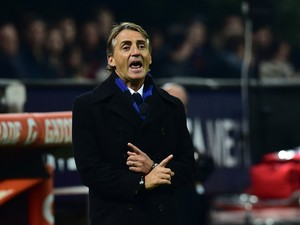 Inter Milan's coach Roberto Mancini gestures during the Serie A football match between AC Milan and Inter at San Siro Stadium in Milan on November 23, 2014