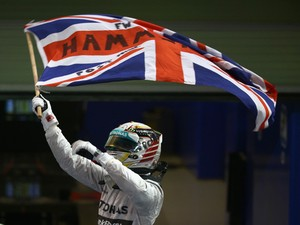 Lewis Hamilton of Great Britain and Mercedes GP celebrates in Parc Ferme after winning the World Championship and the Abu Dhabi Formula One Grand Prix at Yas Marina Circuit on November 23, 2014
