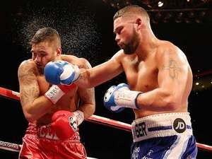 Tony Bellew catches Nathan Cleverly during their Eliminator for the WBO World Cruiserqweight Championship at Liverpool Echo Arena on November 22, 2014