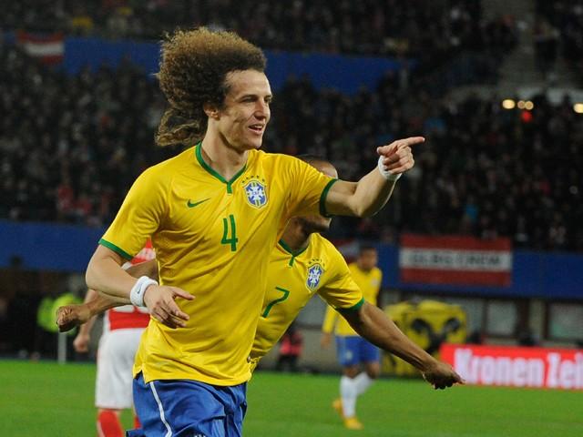 Brazil's defender David Luiz celebrates scoring during a friendly football match Austria vs Brazil at the Ernst Happel Stadium in Vienna on November 18, 2014
