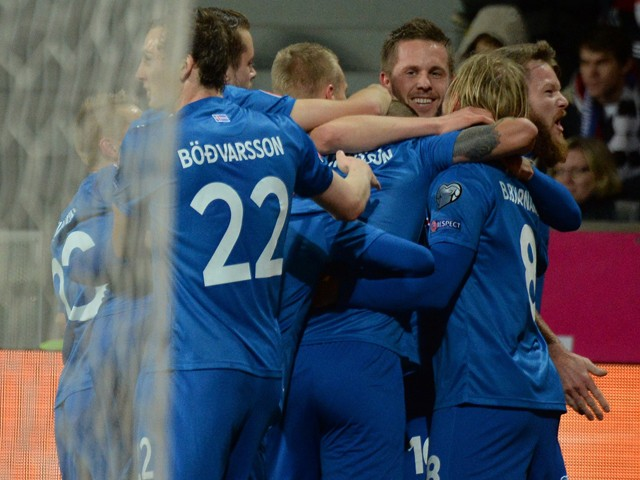 Iceland's players celebrate after scoring 0-1 during the UEFA 2016 European Championship qualifying round Group A football match Czech Republic vs Iceland at the Doosan Arena stadium in Pilsen on November 16, 2014