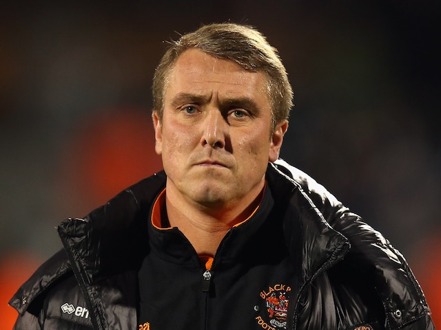 Blackpool Manager Lee Clark looks on prior to the Sky Bet Championship match between Fulham and Blackpool at Craven Cottage on November 5, 2014