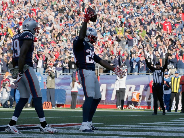 LeGarrette Blount #29 of the New England Patriots reacts after scoring a touchdown during the second quarter against the Detroit Lions at Gillette Stadium on November 23, 2014
