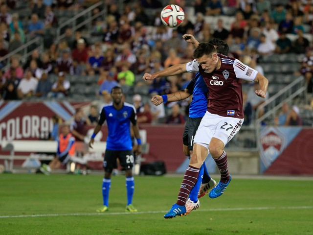 Shane O'Neill #27 of Colorado Rapids battles for control of the ball with Matias Perez Garcia #11 of San Jose Earthquakes at Dick's Sporting Goods Park on September 27, 2014