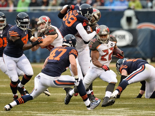 Running back Doug Martin #22 of the Tampa Bay Buccaneers carries the football against free safety Chris Conte #47 of the Chicago Bears in the first quarter at Soldier Field on November 23, 2014
