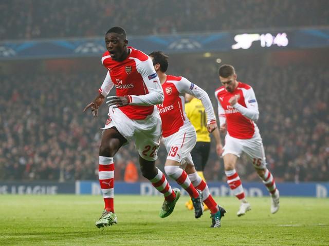 Yaya Sanogo of Arsenal celebrates after scoring the opening goal during the UEFA Champions League Group D match between Arsenal and Borussia Dortmund at the Emirates Stadium on November 26, 2014