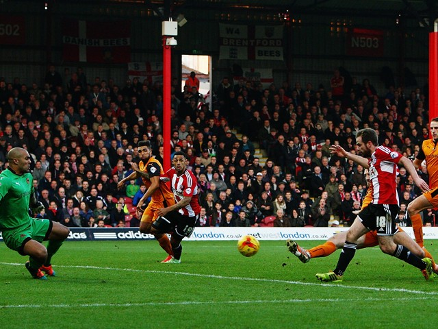 Alan Judge (#18) of Brentford shoots and scores past Carl Ikem the Wolverhampton Wanderers goalkeeper during the Sky Bet Championship match between Brentford and Wolverhampton Wanderers at Griffin Park on November 29, 2014