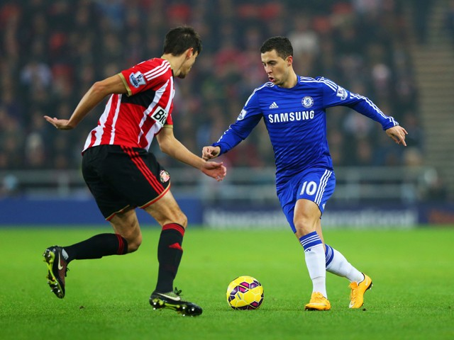 Eden Hazard of Chelsea takes on Santiago Vergini of Sunderland during the Barclays Premier League match between Sunderland and Chelsea at Stadium of Light on November 29, 2014