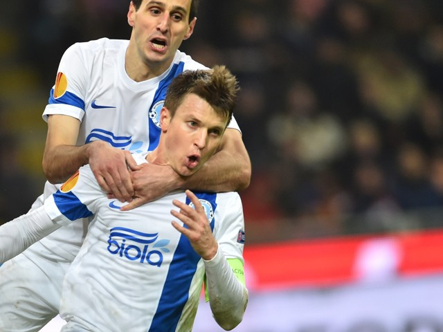 Dnipropetrovsk's midfielder Ruslan Rotan celebrates after scoring a goal with Dnipropetrovsk's forward from Croatia Nikola Kalinic during the UEFA Europa League football match Inter Milan vs Dnipro on November 27, 2014