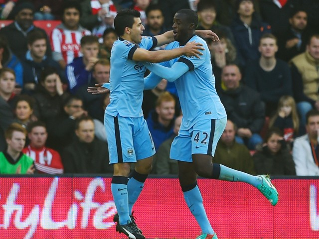 Yaya Toure of Manchester City (R) celebrates with team mate Sergio Aguero as he scores their first goal during the Barclays Premier League match between Southampton and Manchester City at St Mary's Stadium on November 30, 2014