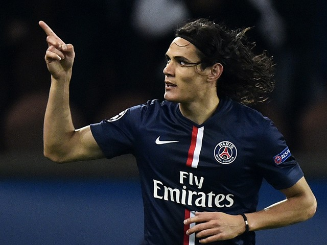 Paris Saint-Germain's Uruguyan forward Edinson Cavani celebrates after scoring a goal during the UEFA Champions League group F football match between Paris Saint-Germain and Ajax Amsterdam on November 25, 2014