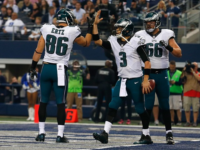 Mark Sanchez #3 of the Philadelphia Eagles is congratulated by Zach Ertz #86 of the Philadelphia Eagles as Andrew Gardner #66 of the Philadelphia Eagles is near after he scored a touchdown against the Dallas Cowboys in the first half at AT&T Stadium on No