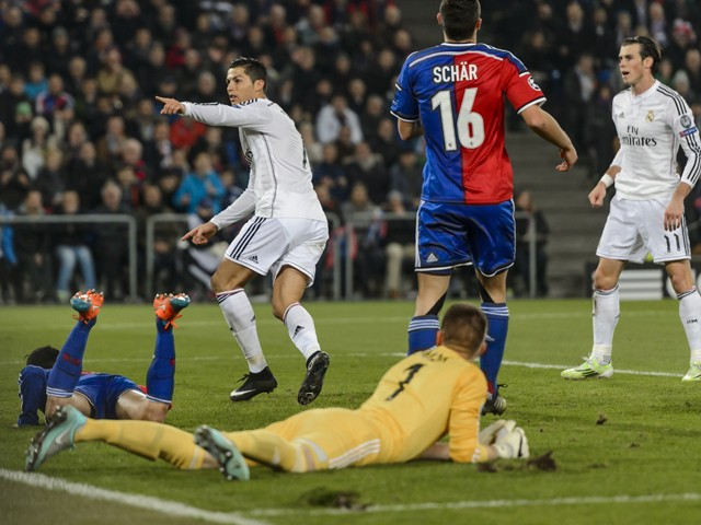Real Madrid's Portuguese forward Cristiano Ronaldo gestures next to teammate Welsh forward Gareth Bale after scoring his team's first goal on November 26, 2014
