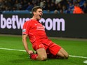 Steven Gerrard of Liverpool celebrates after scoring his team's second goal during the Barclays Premier League match between Leicester City and Liverpool at The King Power Stadium on December 2, 2014