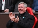 Alex Ferguson applauds.