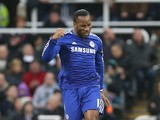 Chelsea's Ivorian striker Didier Drogba celebrates scoring their first goal during the English Premier League football match between Newcastle United and Chelsea at St James Park in Newcastle-Upon-Tyne, north east England, on December 6, 2014