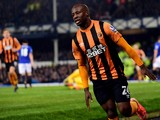 Hull City's Nigerian midfielder Sone Aluko celebrates scoring their first goal during the English Premier League football match between Everton and Hull City at Good