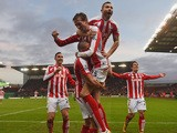 Jon Walters of Stoke is mobed by Phil Bardsley and Peter Crouch after scoring to make it 3-0 during the Barclays Premier League match between Stoke City and Arsenal at Britannia Stadium on December 6, 2014