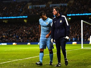 Sergio Aguero of Manchester City leaves the field injured during the Barclays Premier League match against Everton on December 6, 2014