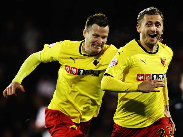 Almen Abdi (right) of Watford celebrates with team mates after scoring his sides fourth goal during the Sky Bet Championship match against Fulham on December 5, 2014