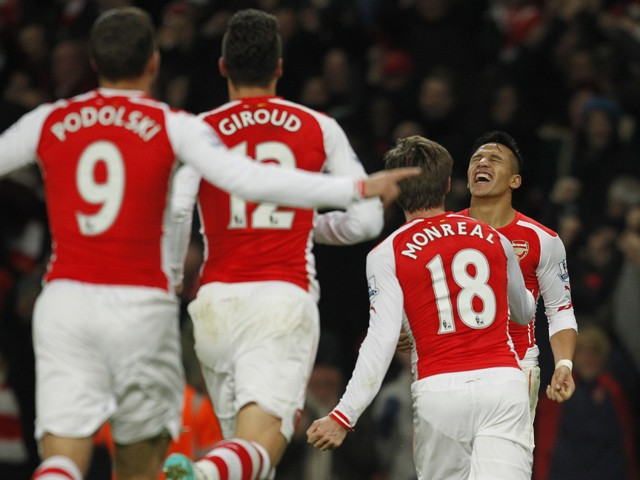 Arsenals Chilean striker Alexis Sanchez celebrates scoring the winning goal of the English Premier League football match between Arsenal and Southampton at the Emirates Stadium in London on December 3, 2014