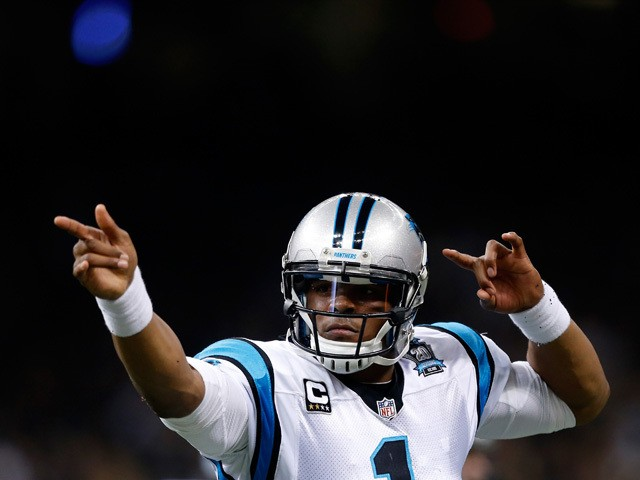 Cam Newton #1 of the Carolina Panthers celebrates after scoring a touchdown in the first half against the New Orleans Saints at Mercedes-Benz Superdome on December 7, 2014