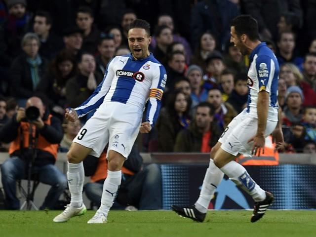 Espanyol's forward Sergio Garcia celebrates with Espanyol's defender Alvaro Gonzalez after scoring during the Spanish league football match FC Barcelona vs RCD Espanyol at the Camp Nou stadium in Barcelona on December 7, 2014