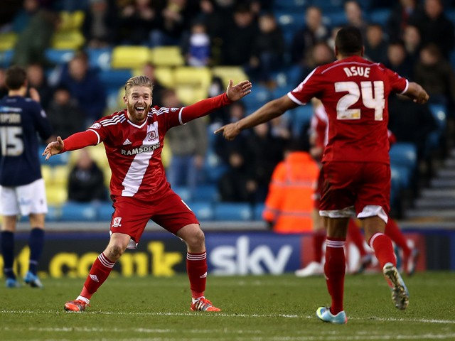 Adam Clayton of Middlesbrough celebrates after Jelle Vossen scores to make it 4-0 during the Sky Bet Championship match between Millwall and Middlesbrough at The Den on December 6, 2014