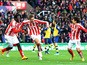 Peter Crouch of Stoke City celebrates scoring the opening goal during the Barclays Premier League match between Stoke City and Arsenal at the Britannia Stadium on December 6, 2014