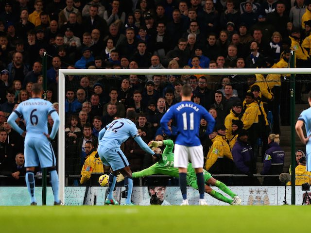 Yaya Toure of Manchester City slots home from the penalty spot to open the scoring in the Premier League match against Everton at the Etihad on December 6, 2014
