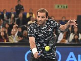 US tennis player Pete Sampras returns the ball to Croatia's Goran Ivanisevic during the International Premier Tennis League (IPTL) former champions singles match in New Delhi on December 8, 2014