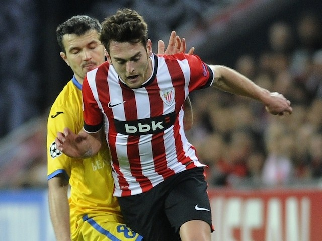 Bate Borisov's midfielder Aleksandr Volodko (L) vies with Athletic Bilbao's forward Ibai Gomez (R) during the UEFA Champions League Group H football match on December 10, 2014