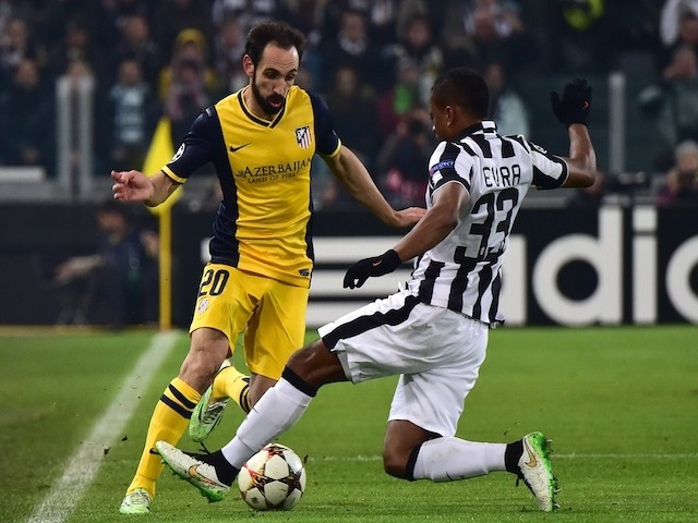 Juventus' defender from France Patrice Evra (R) fights for the ball with Atletico Madrid's defender Juanfran during the UEFA Champions League football match on December 9, 2014