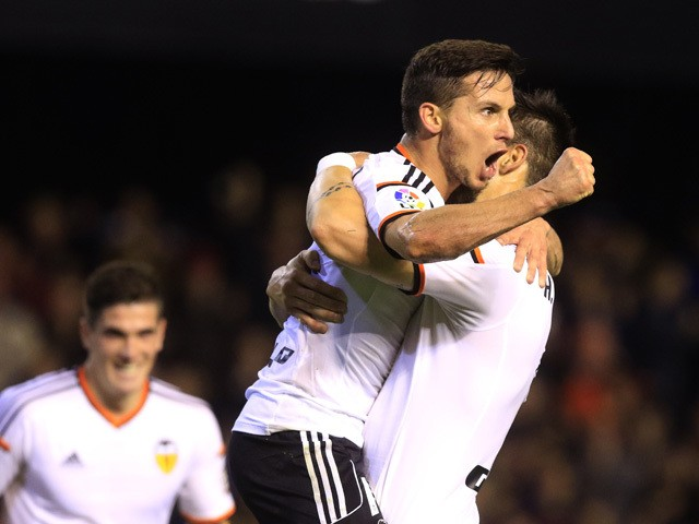 Valencia's Argentinian forward Pablo Piatti celebrates his goal with Valencia's forward Alvaro Negredo during the Spanish league football match Valencia CF vs Rayo Vallecano at the Mestalla stadium in Valencia on December 13, 2014