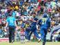Sri Lankan cricketer Suranga Lakmal celebrates with teammates the dismissal of England cricketer Eoin Morgan during the sixth One Day International (ODI) match between Sri Lanka and England at the Pallekele International Cricket Stadium in Pallekele on De