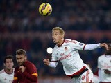 AC Milan's midfielder from Japan Keisuke Honda heads the ball against Roma during the serie A football match in Rome's Olympic Stadium on December 20, 2014