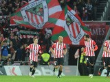 Athletic Bilbao's midfielder Mikel Rico celebrates with teammates Athletic Bilbao's forward Iker Muniain and Athletic Bilbao's defender Mikel Balenziaga during the Spanish league football match Athletic Club Bilbao vs Club Atletico de Madrid at the San Ma