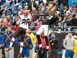 Kelvin Benjamin #13 of the Carolina Panthers makes a leaping catch against Pierre Desir #26 of the Cleveland Browns in the 1st half during their game at Bank of America Stadium on December 21, 2014