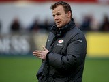 Saracens director of rugby Mark McCall keeps an eye on the warm up during the Aviva Premiership match between Saracens and London Welsh at Allianz Park on December 20, 2014