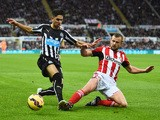 Ayoze Perez of Newcastle United is challenged by Lee Cattermole of Sunderland during the Barclays Premier League match between Newcastle United and Sunderland at St James' Park on December 21, 2014