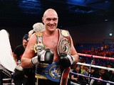 Tyson Fury of England celebrates defeating Dereck Chisora of England in th