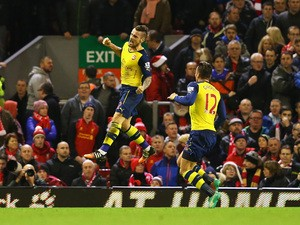 Mathieu Debuchy of Arsenal celebrates scoring his goal during the Barclays Premier League match between Liverpool and Arsenal at Anfield on December 21, 2014