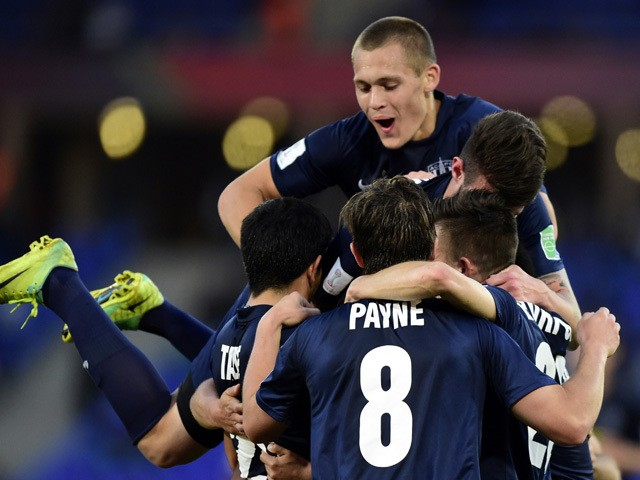 Auckland City players celebrate after scoring a goal during their FIFA Club World Cup third place football match at Marrakesh stadium in Marrakesh on December 20, 2014