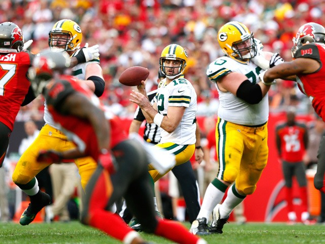 Aaron Rodgers #12 of the Green Bay Packers looks to pass against the Tampa Bay Buccaneers at Raymond James Stadium on December 21, 2014