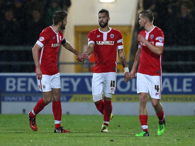 Kane Hemmings of Barnsley(C) celebrates his goal with team mates during the FA Cup Second Round Replay match against Chester City on December 16, 2014